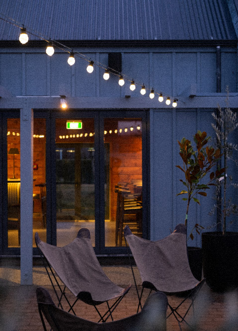 Wanaka restaurant, outdoor courtyard with lights and outdoor seating