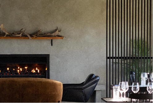 Wanaka Restaurant, seatign area with fireplace and couches